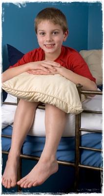 Boy on Metal Loft Bed